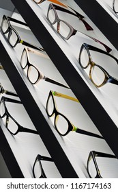 Close up of stylish glasses on shelves