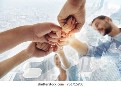 Close up of successful team with fists together