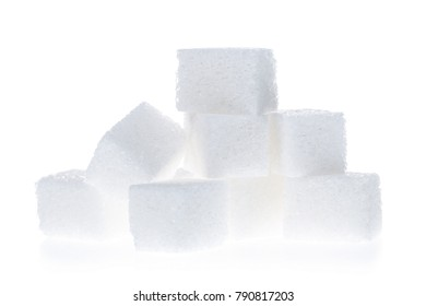 Close up of sugar cubes isolated on white background.