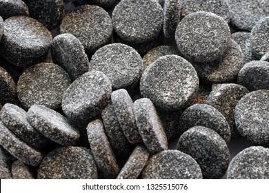Close up of sugared salty liquorice. Also know as salmiak or salmiac liquorice. In Finnish it's known as salmiakki.
