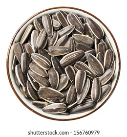 Close up sunflower seed in ceramic dish isolated on white - with path