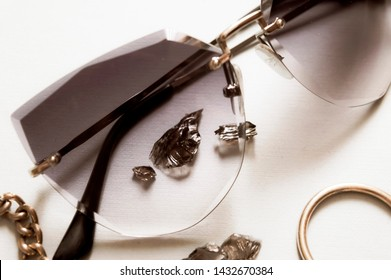 Close up sunglases and jewerly black stone, ring necklace. Fashion background.