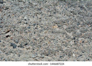 A close up of the surface of slag concrete.