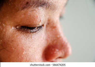 Close up sweating water drop on eyes asian woman. focus sweat on eyes. Sport female exercise in fitness.