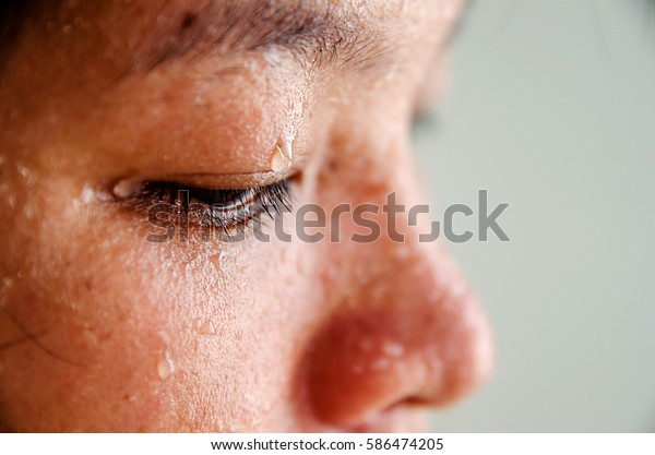 Close up of sweating water drop on eyes asian woman. focus sweat on eyes. Sport female exercise in fitness.