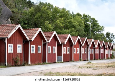 Close to the Swedish skerry archipelago in the province of Bohuslan, these traditional boathouses are located in a small harbor.