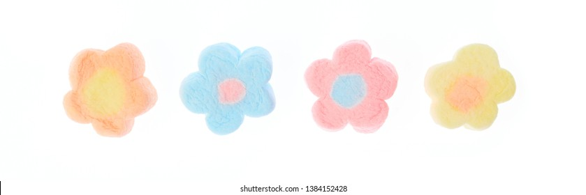 Close Up of sweet marshmallow in the shape of flower isolated on white background