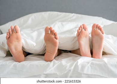 Close up Sweet Partners Soles on White Bed with Cover