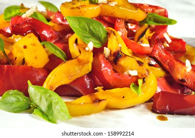 Close up of sweet peppers salad on white plate.Grilled vegetables, mediterranean food, dieting.