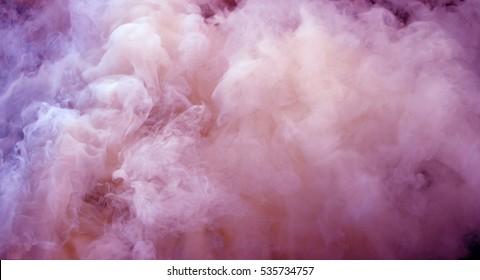 close up swirling pink purple and white smoke background