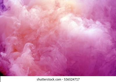close up swirling pink and white smoke background