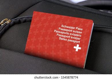 Close up of Switzerland Passport in Black Suitcase Pocket
