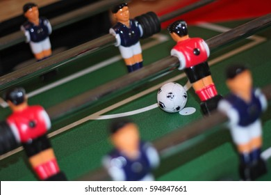 Close up of table football players in penalty area action. The ball is on the spot and there is a chance to score a goal. Flash