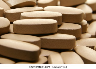 Close up of tablets / A tablet is a compressed powder in solid form .
