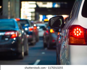 Close up of tail light of a car waiting in long queue of traffic. Stopped car with its brake lights on in the city of Melbourne, Australia.