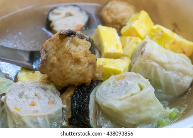 The close up of Taiwanese oden meat balls in soup at food street night market in Taipei, Taiwan.