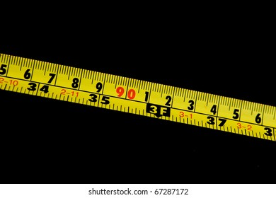 Close up of tape measure isolated on black, could be used as logo