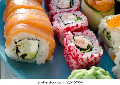 Close up of tasty fresh sushi rolls with fish and rice on plate
