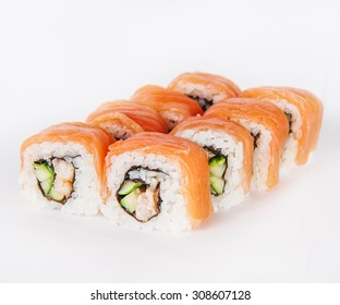 Close up Tasty Salmon sushi rolls with shrimps and  Cucumber isolated on a white background