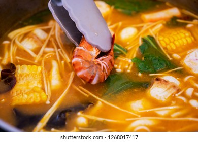 Close up of tasty tom yum seafood soup with boiled shrimp