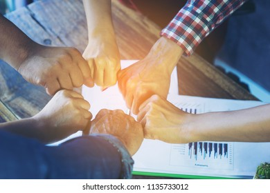 Close up of teamwork or partners giving fist bump,Business people giving fist bump, teamwork concept.