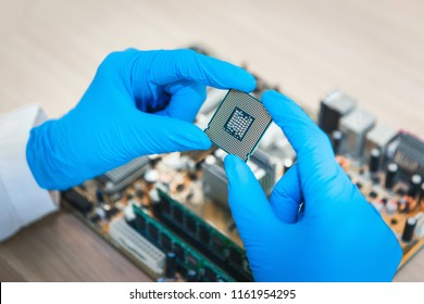 Close up of technician scientist hand holding CPU's personal computer., Researcher and occupation concept.