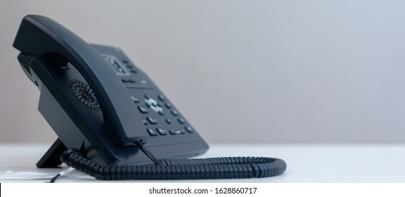 close up telephone VOIP technology standing on office desk in office room for contacting with colleagues , partner or vendor and network operation center job concept - Shutterstock ID 1628860717