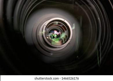 close up of a television lens  on a dark background. Camera lens,Macro of an iris,Camera - Photographic Equipment, Lens - Optical Instrument, Circle, Metal, Single Object.