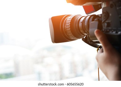 close up of television operator with camera.