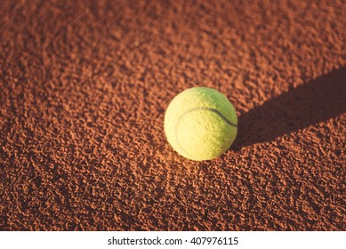 Close up of tennis ball on clay court,  vintage tone