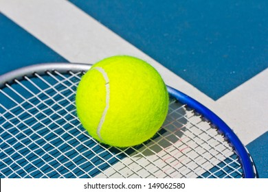 Close up of a tennis ball on racket