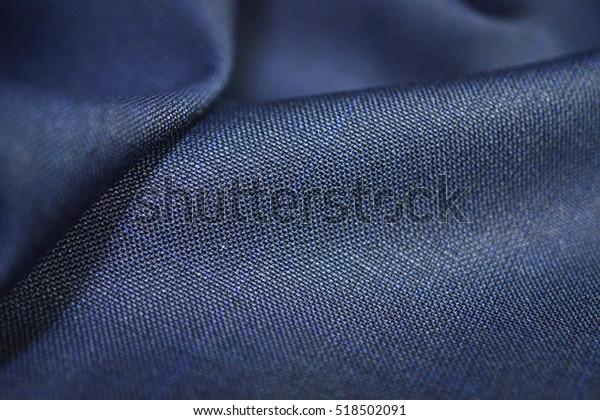 Nahaufnahme der Textur blauer Stoff des Anzugs, Foto-Aufnahme nach Tiefenfach für Objekt