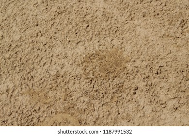 A close texture view of the dirt on the ground in a baseball infield field.