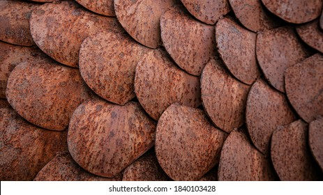 Close up textured background of rusted metal fish scale shapes - horizontal format
