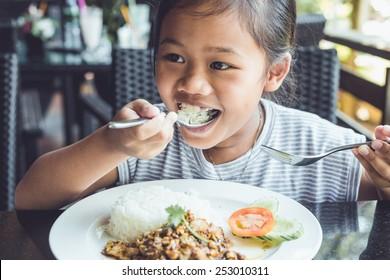 Close up Thai children eating in restaurant