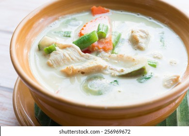 Close up Thai green curry intense soup with chicken