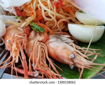 Close up of Thai seafood salad consist of prawns, rice noodle, papaya salad, clams, cuttlefish and boiled eggs