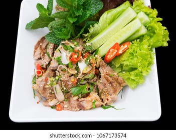 close up Thai style Grilled pork neck salad. isolated on black.