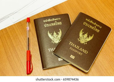 Close up Thailand passport and on wood