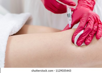 Close up of thigh injection , body shaping treatment.
