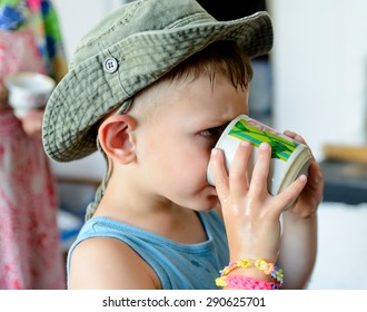 Close up Thirsty Cute White Young Boy with Cowboy Hat, Drinking Water on a Glass Seriously