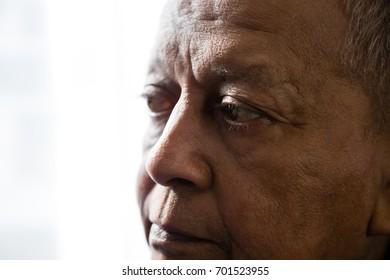 Close up of thoughtful senior man looking away