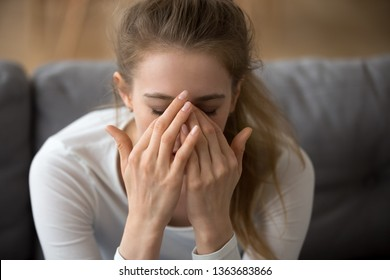 Close up thoughtful woman with closed eyes covered face in hands, feeling pain, having problem with relationships or health, headache, upset tired girl worried about future, making hard decision