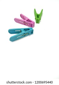 Close up three colored plastic clothespins with space on the bottom, isolated on a white background. Red, green and blue clothespins use for clamp or hang clothes on the rope for dry after laundry.