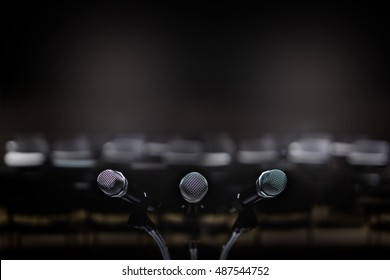 Close up of three microphone in meeting room or conference room blur background.