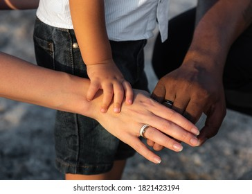 Close up of three multiracial family person stack their palms. Multi racial love and integration between diversity