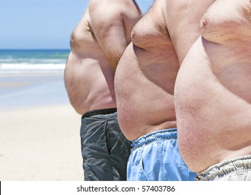Close up of three obese fat men on the beach showing their unhealthy bellies