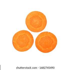 Close up three round thin cut slices of fresh carrot, backlit and isolated on white background