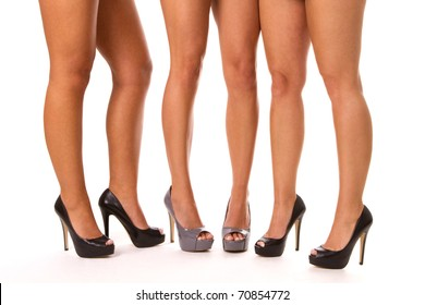 Close up of three women's legs in high heeled shoes.