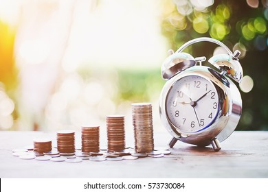 Close up of time and money with green bokeh background ,Business Finance and Money concept,Save money for prepare in the future.time is money concept